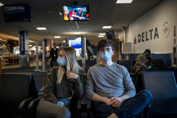 Passengers wearing face mask at LaGuardia Airport because of COVID-19 pandemic stock photo