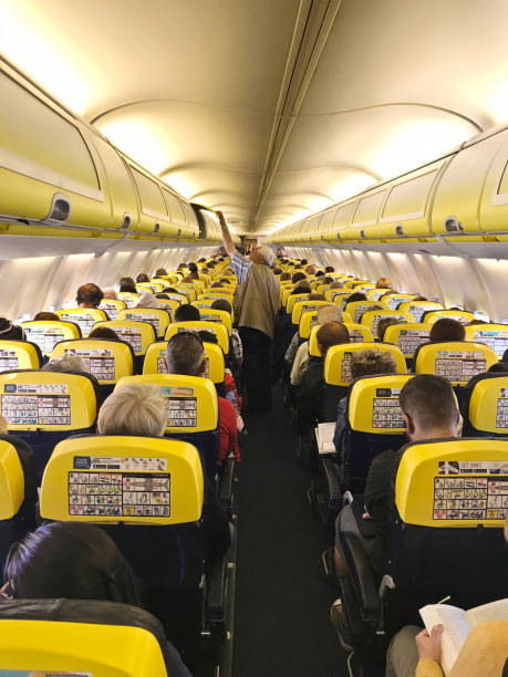 Passengerstourists on board a fully booked ryanair flight from picture id1078221182?b=1&k=6&m=1078221182&s=612x612&w=0&h=kwlzwdezftetnct1tvznwqukqdydqnukjljiuiplfoo=