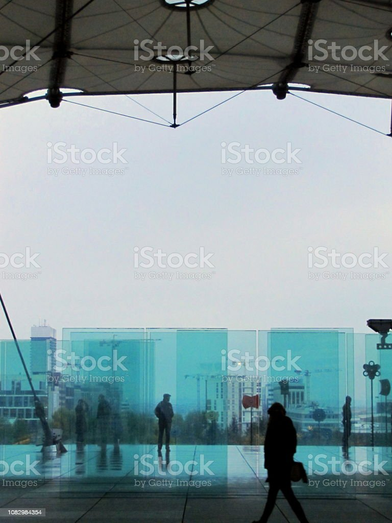 Passers-by in the blue cold light