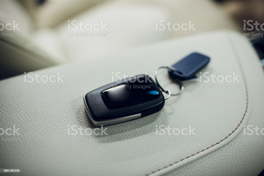 Passing car keys. Cropped closeup car dealer holding out car keys camera copyspace car dealership salon manager salesman selling buying giving owner profession purchase vehicle concept zbiór zdjęć royalty-free