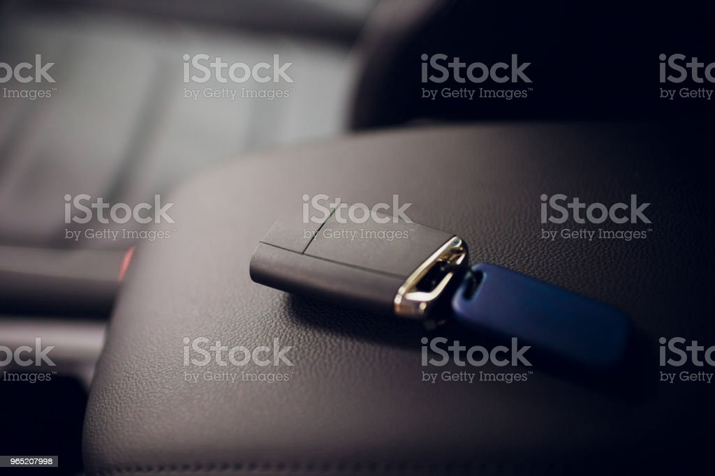 Passing car keys. Cropped closeup car dealer holding out car keys camera copyspace car dealership salon manager salesman selling buying giving owner profession purchase vehicle concept royalty-free stock photo