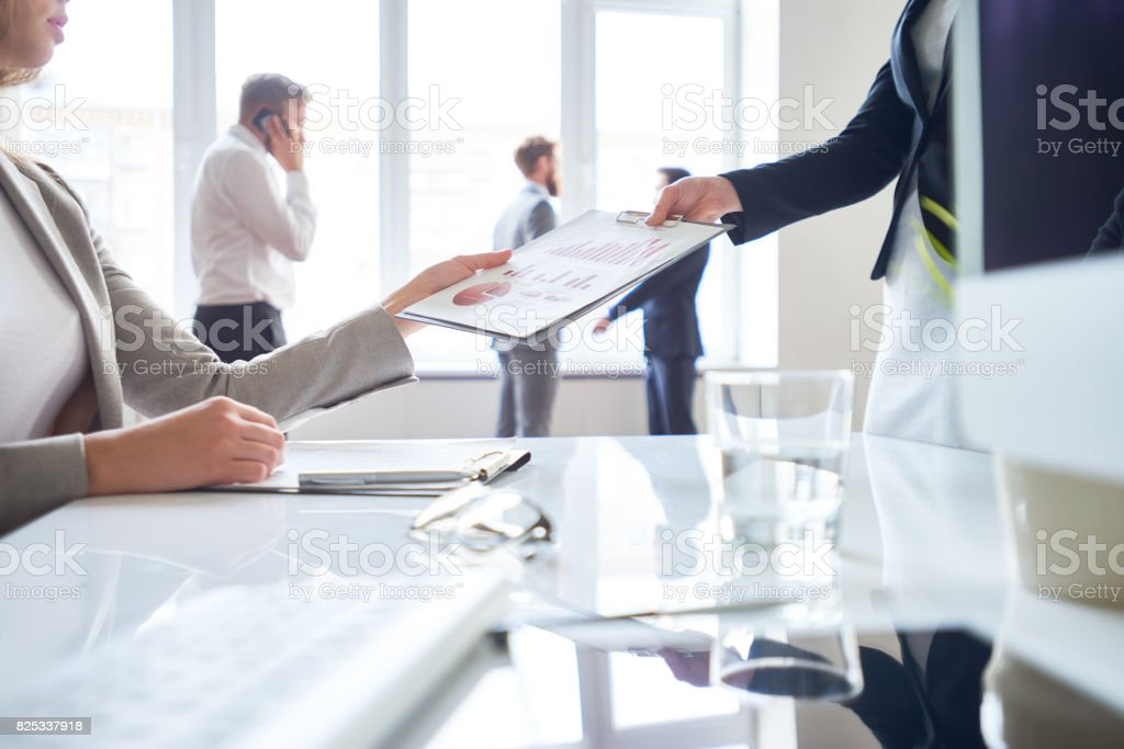 Passing financial document stock photo