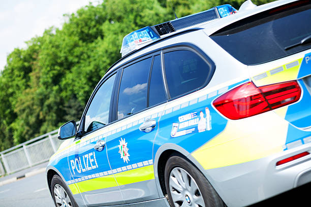 Passing German police car Essen, Germany - July 21, 2016: Capture of passing German police car on duty. Motion blurred shot. north rhine westphalia stock pictures, royalty-free photos & images