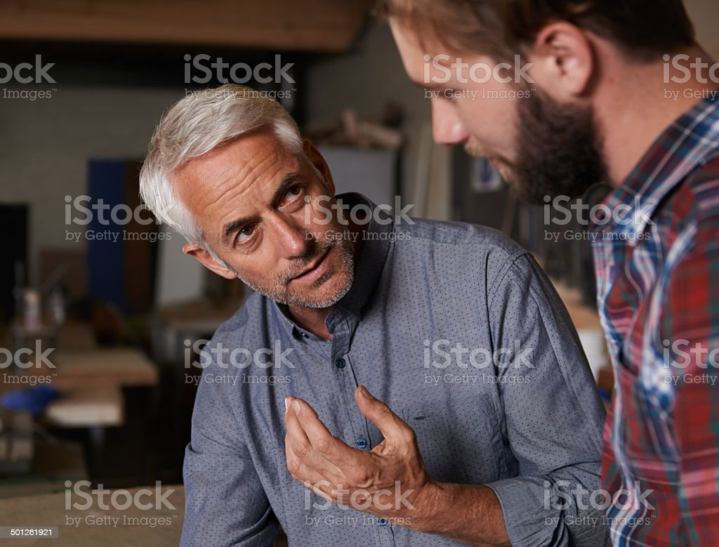 Passing on all his knowledge stock photo