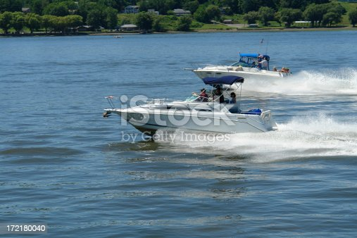 Two passing speedboats