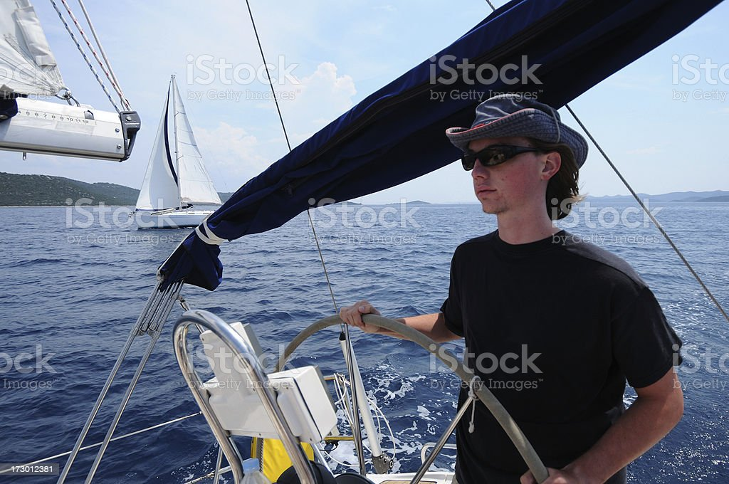 Passing the competitive sailing boat royalty-free stock photo