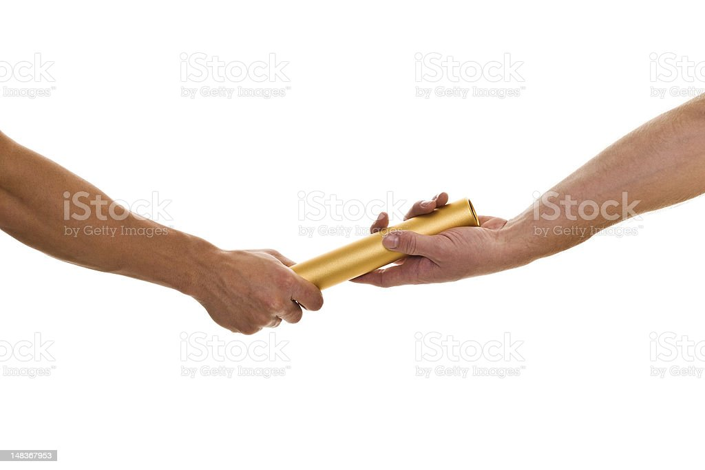 Passing the gold baton between hands stock photo