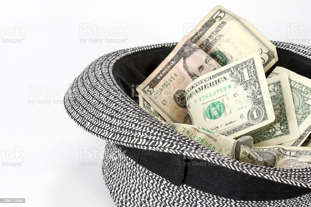 Passing the Hat - Black and White Hat with Cash stock photo