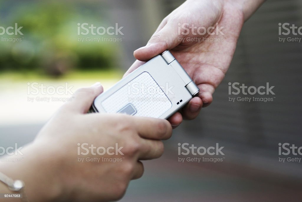 Passing the phone #2 royalty-free stock photo