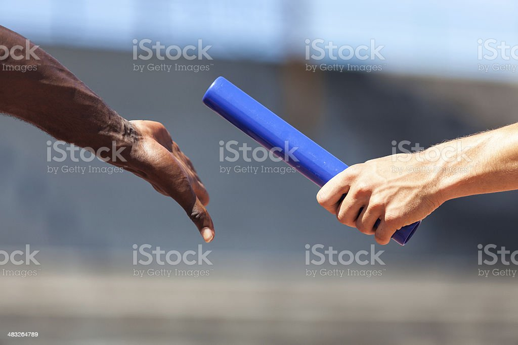 Passing the Relay Baton royalty-free stock photo