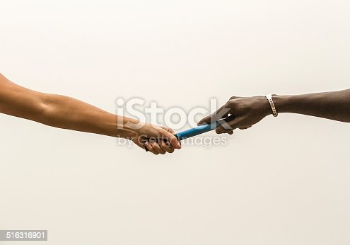 White woman and Black man Passing the Relay Baton