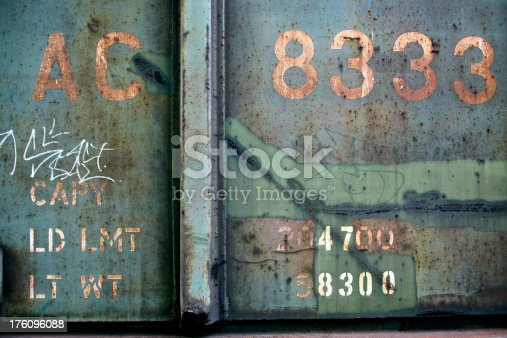 Freight car showing weathered and rusted surface with small graffiti action.