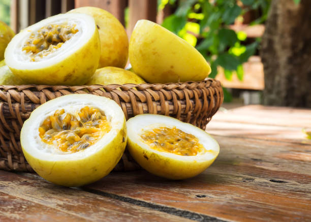passion fruit in bamboo basket. tropical fruit. - passiflora foto e immagini stock