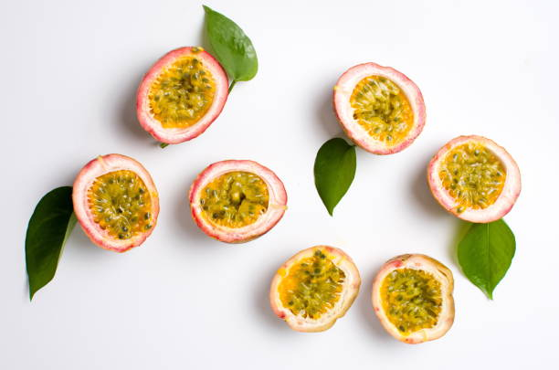 passion fruit isolated on white background - passiflora foto e immagini stock