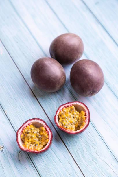 passion fruit on a blue wooden table stock photo