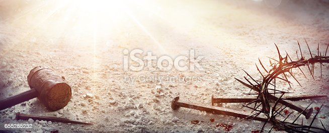 istock Passion Of Jesus Christ - Hammer and Bloody Nails And Crown Of Thorns On Arid Ground 655285232