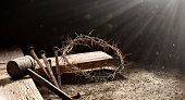 istock Passion Of Jesus  - Wooden Cross With Crown Of Thorns Hammer And Bloody Spikes 1302129871