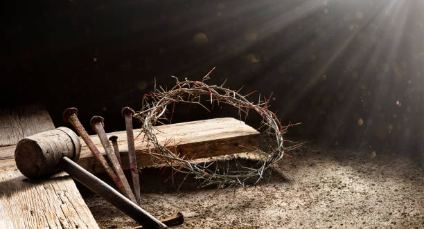 Passion Of Jesus  - Wooden Cross With Crown Of Thorns Hammer And Bloody Spikes stock photo