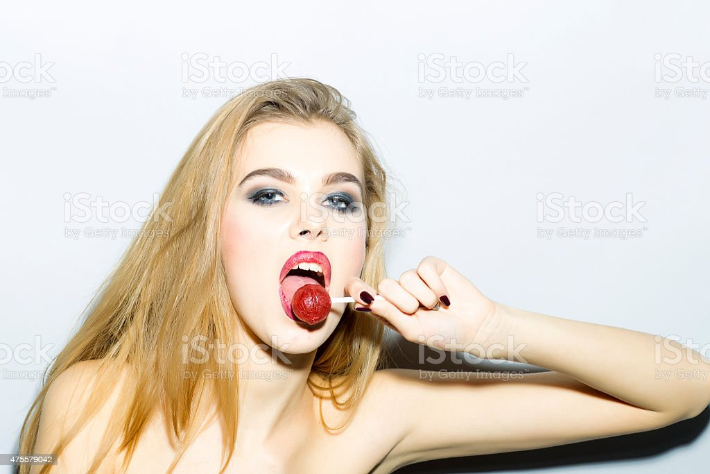 Passionate blonde girl portrait with sugar candy stock photo