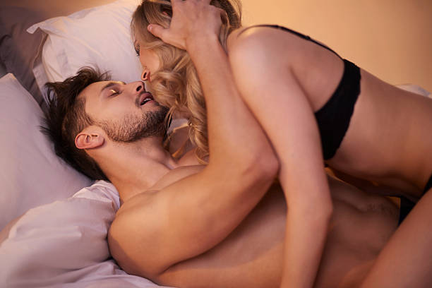 passionate couple in the bedroom - sexual issues stock photos and pictures