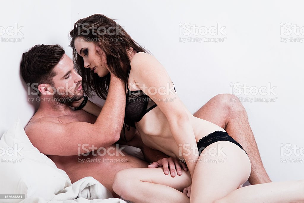 Passionate Couple on the Bed stock photo