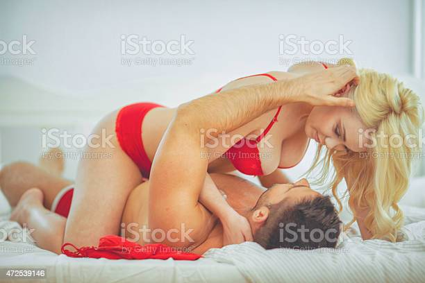 couple  share a moment of romantic affection.