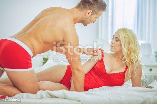 istock passionate couple 472596940