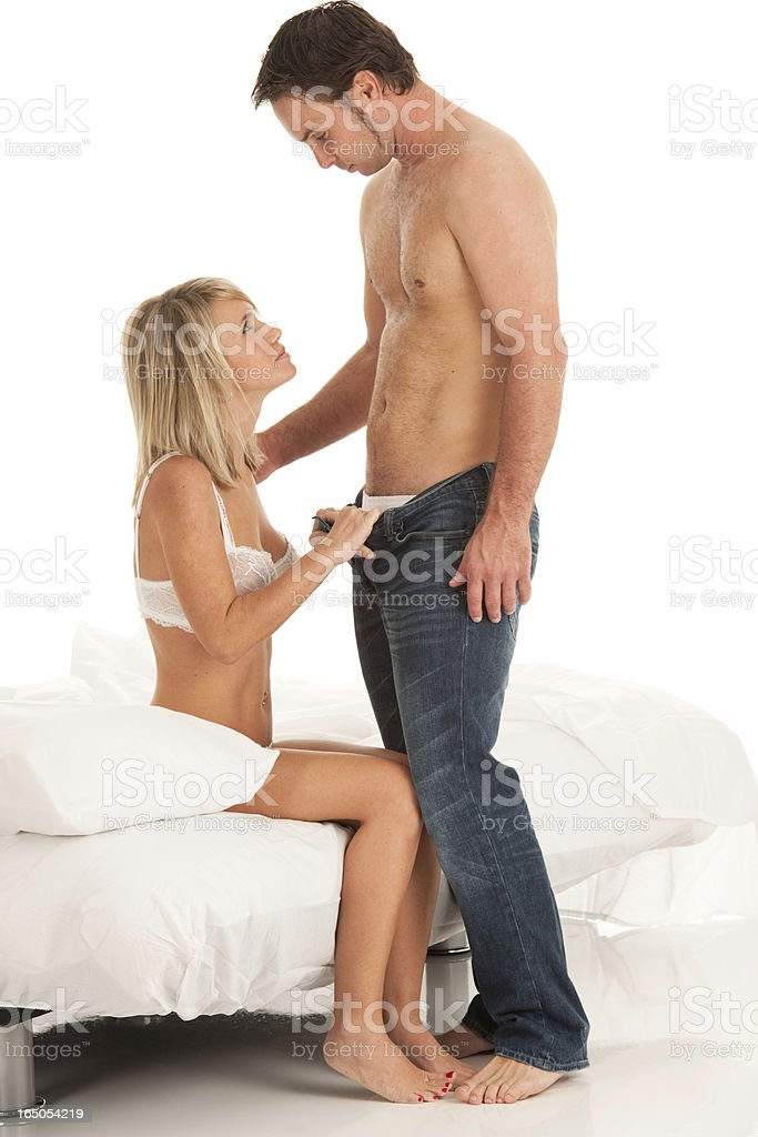 Passionate Couple - She Pulls Him Close to the Bed stock photo