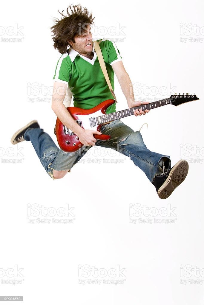 passionate guitar player jumps stock photo