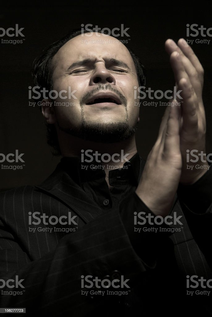 Passionate Man Clapping and Singing stock photo