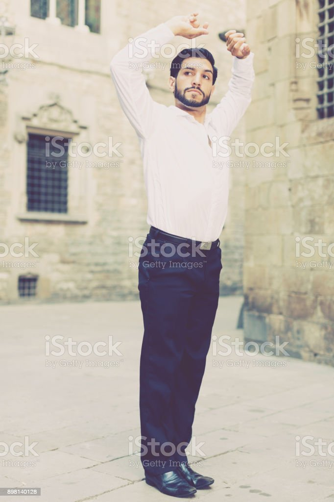 Passionate man dancing alone outdoors stock photo