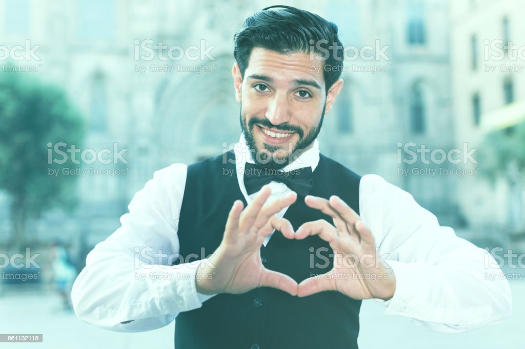 Passionate man making heart with finger royalty-free stock photo