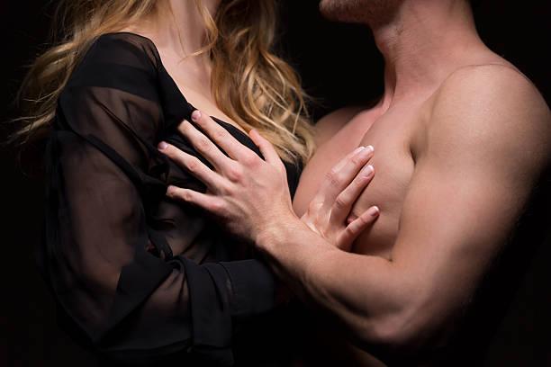 Female breast touching man Caressing Women: