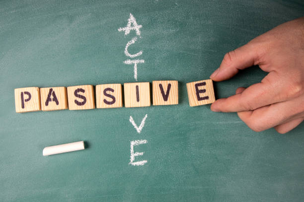 Passive and Active. Text from letters of the wooden alphabet stock photo