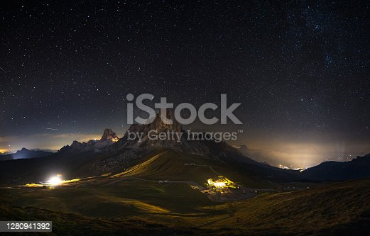 istock Passo Giau and Mount Nuvolau and Averau under a sky full of stars in Cortina D'ampezzo, famous ski resort in the Dolomites 1280941392