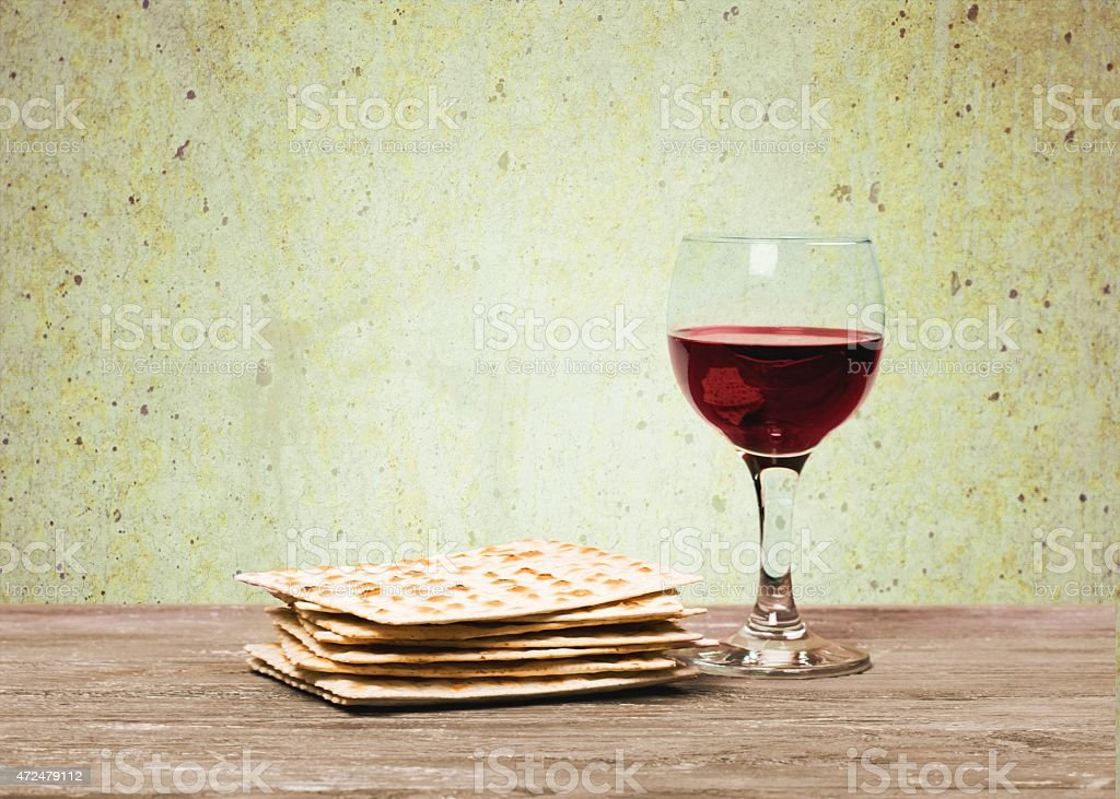 Passover background. wine and matzoh (jewish passover bread)  over wooden stock photo