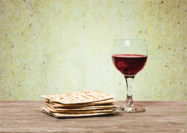 passover background. wine and matzoh (jewish passover bread)  over wooden - passover stock photos and pictures