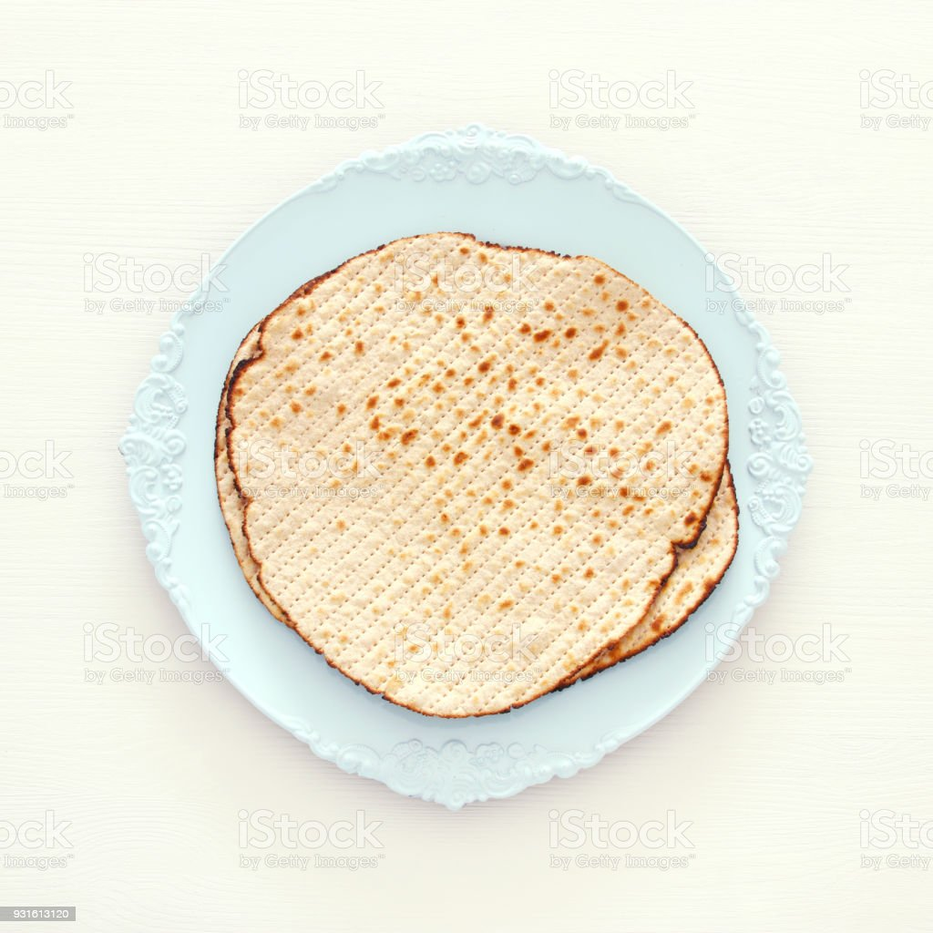 passover background with matzoh isolated on white. stock photo