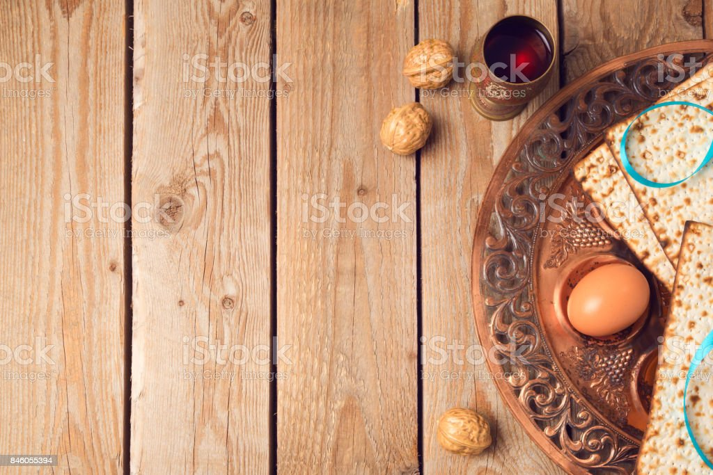 Passover concept with matzah, seder plate and wine on wooden background. View from above stock photo