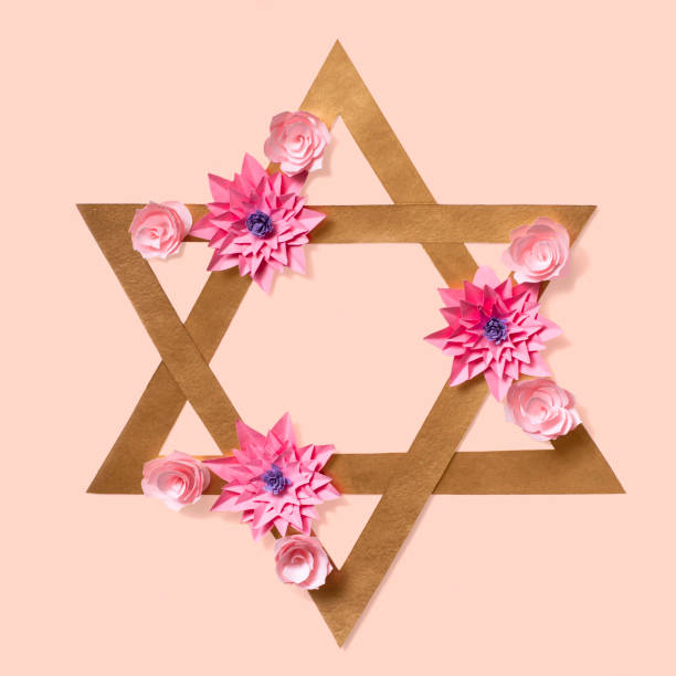 Passover greeting card with Star of David in flowers stock photo