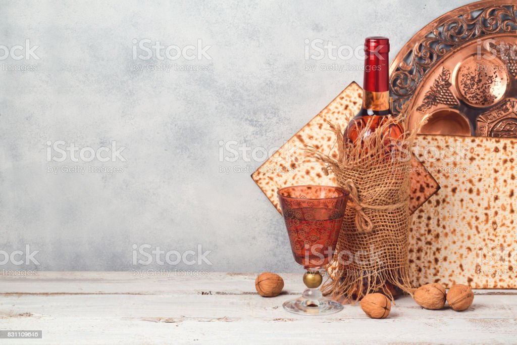 Passover holiday concept with wine and matzoh over rustic background with copy space stock photo
