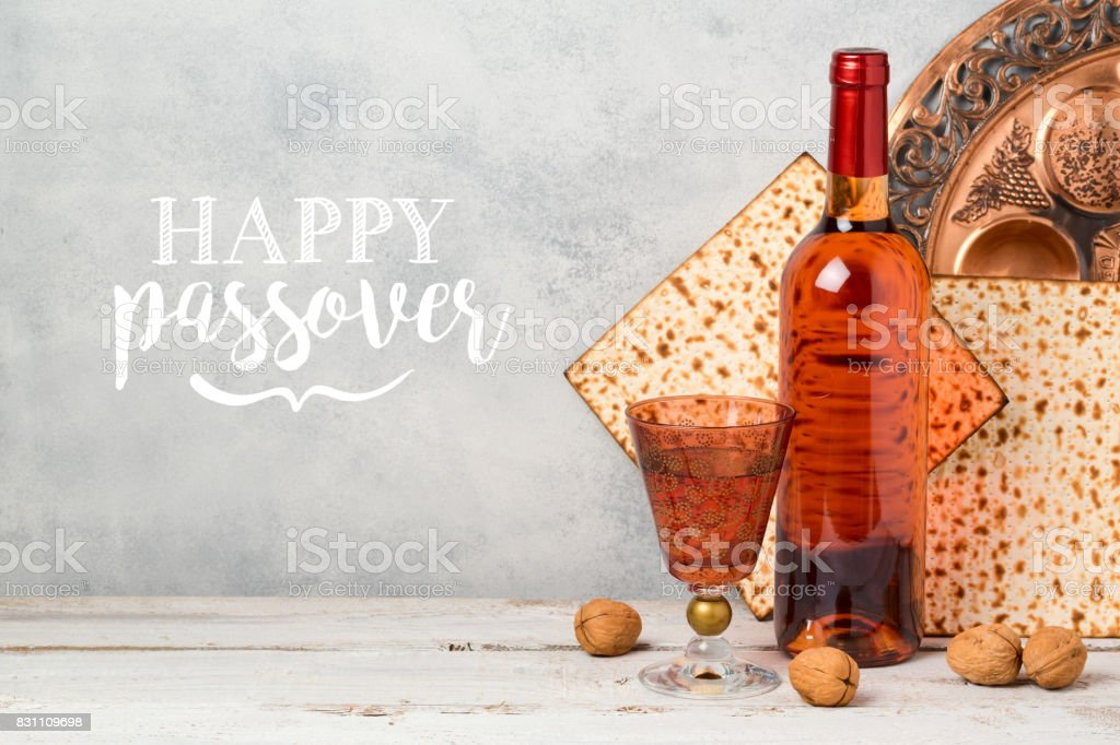 Passover holiday greeting card with wine and matzoh over rustic background stock photo