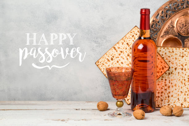 passover holiday greeting card with wine and matzoh over rustic background - passover stock photos and pictures