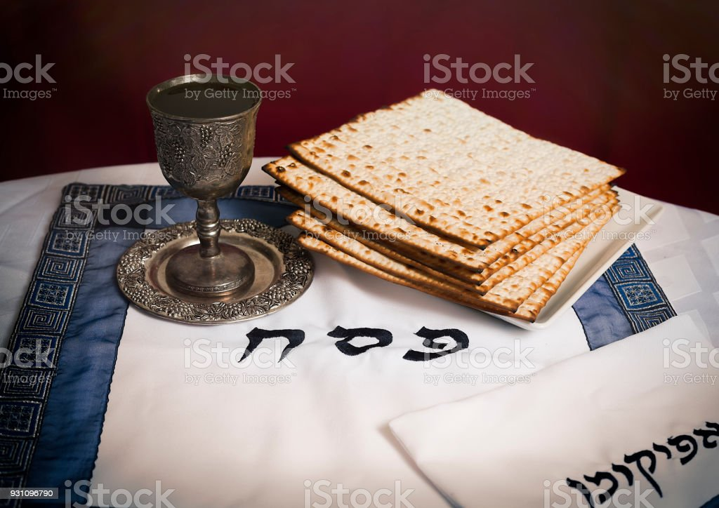 Passover- Matzo and kiddush cup with wine stock photo