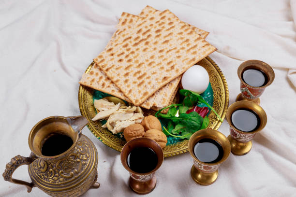 Passover matzoh jewish holiday bread with kiddush four cup of wine Jewish family celebrating passover, matzoh jewish holiday bread with kiddush four cup of wine passover stock pictures, royalty-free photos & images