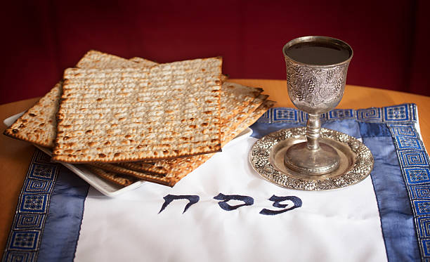 Passover Matzo and a wine in a Kiddush cup with the words PESACH (Passover in Hebrew). passover stock pictures, royalty-free photos & images