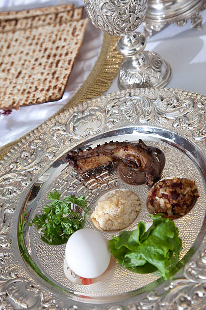 Passover Seder Plate Traditional symbols on a seder plate for the Jewish festival of Passover. seder plate stock pictures, royalty-free photos & images