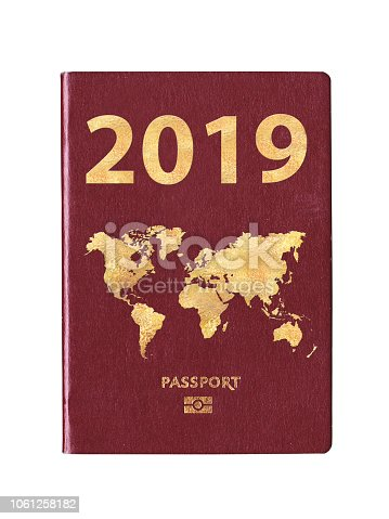 istock Passport 2019 with a world map on the cover, concept 1061258182