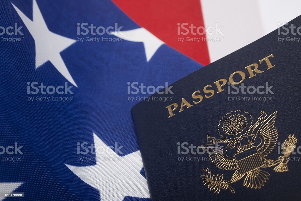 Passport against a background of the American flag. royalty-free stock photo