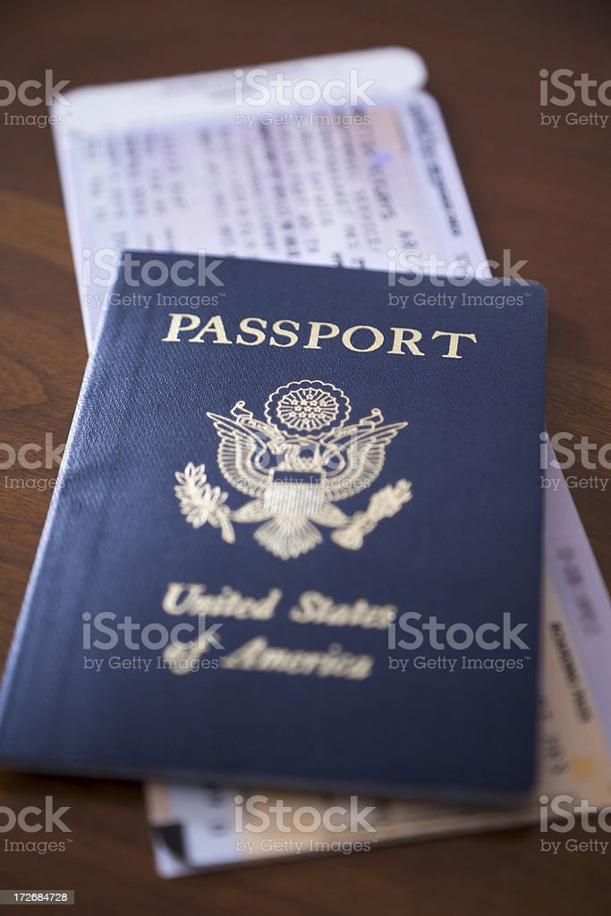 passport and airplane ticket on desk or table royalty-free stock photo
